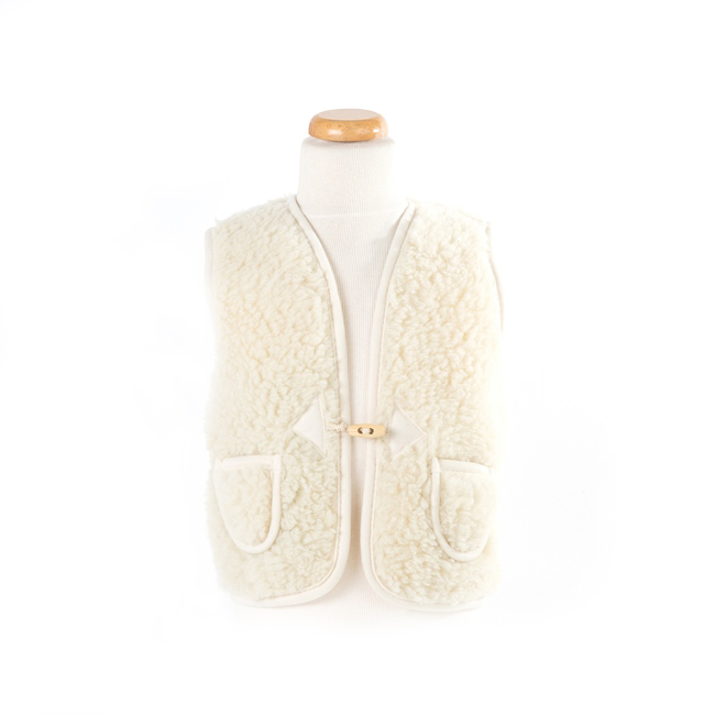 gilet en laine de mouton mixte enfant intérieur laine naturelle de mouton blanc écru lainage veste sans manche gilet de berger dt collection importateur gros