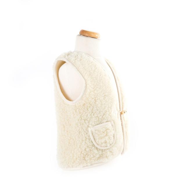 gilet en laine de mouton mixte enfant intérieur laine naturelle de mouton blanc écru lainage veste sans manche gilet de berger vraie dt collection grossiste vente en gros
