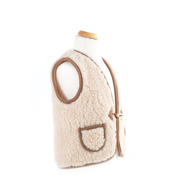 gilet en laine de mouton mixte enfant intérieur laine naturelle de mouton marron beige écru lainage veste sans manche gilet de berger vraie laine direct tannerie grossiste vente en gros lot