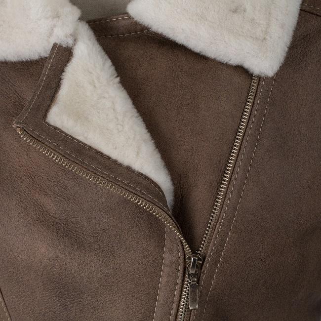 Veste femme natty en peau d`agneau double face fourrure mouton intérieur peau lainée cuir marron glacé laine blanche court fermeture zip poche couture cintré grossiste importateur